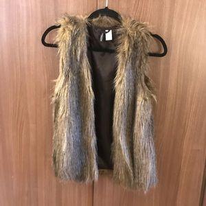 Super cute fur vest!